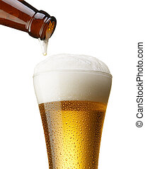 beer in bottle pouring into glass, isolated