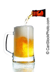 Pouring Beer - beer pouring from bottle into mug isolated
