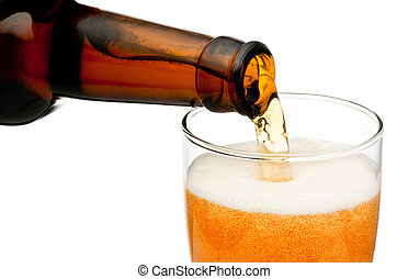 Pouring beer from bottle isolated on white background
