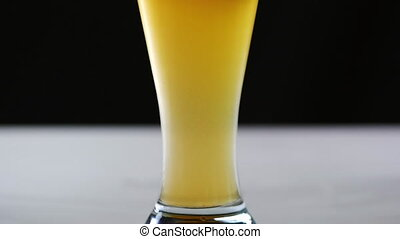 Pouring beer into the glass.
