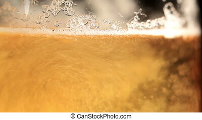 Pouring beer. Macro shot.