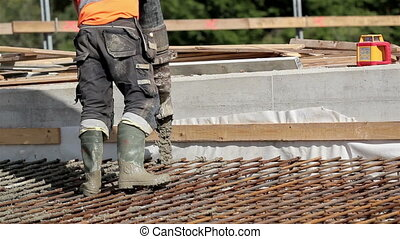 Pouring cement on a deep area to equalize the depth of the...