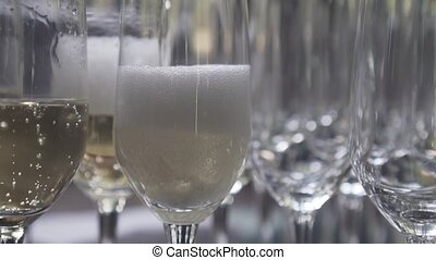 Pouring champagne into the glass - Closeup of pouring...