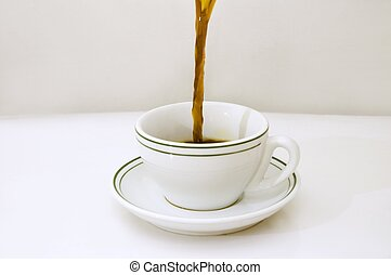 Pouring coffee cup - Black coffee being poured on a white ...