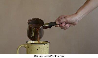 Pouring coffee into a big mug