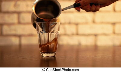 Pouring coffee into cup in modern kitchen. Good morning...