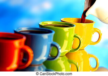 Pouring coffee on colorful cups
