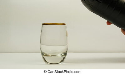 Pouring coke or cola or soda from the bottle into a glass on white background.