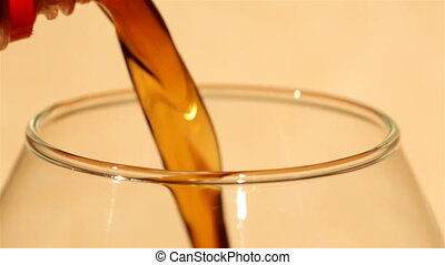 Pouring cola into a glass and filli