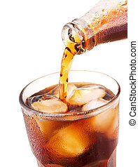 pouring cola into glass with ice from bottle