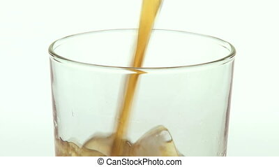 Pouring Cola soft drink - Close up of pouring cola into a...