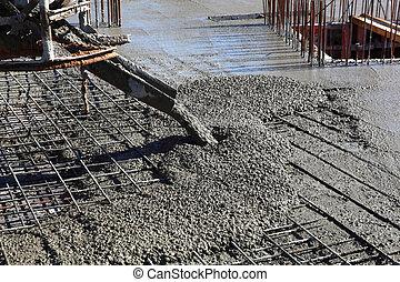 Pouring Concrete at Construction Site
