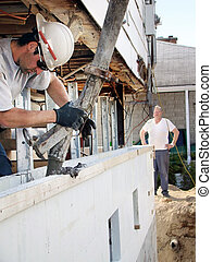 Pouring concrete in styrofoam foundation - Construction or ...