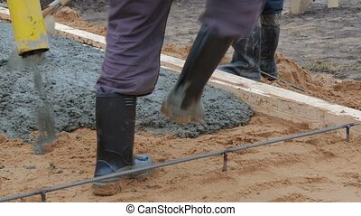Pouring concrete into the floor screed on the ground
