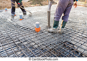 pouring concrete slab - concrete pouring during commercial...