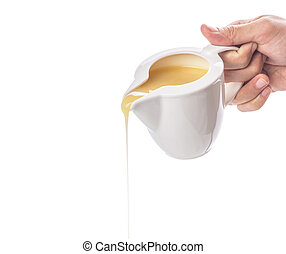 Female hand pouring condensed milk over white background
