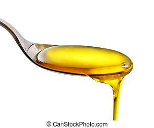 pouring cooking oil - spoon of cooking oil on a white ...