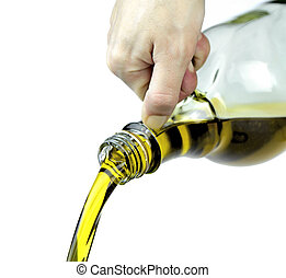 Pouring extra virgin olive oil from glass bottle