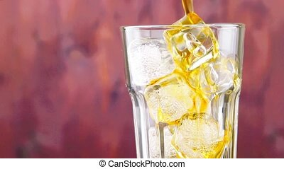 pouring fresh coke with ice cubes on wood background, summer time concept