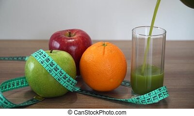 Pouring Fresh Green Smoothie and Fruits