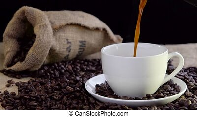 pouring fresh tasty coffee into cup - pouring fresh tasty...