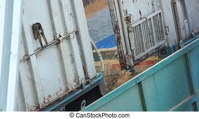 Pouring graing from truck, close up. Unloading cargo...