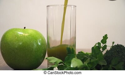 Pouring Green Juice Into Glass