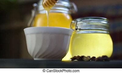 Pouring honey at bowl