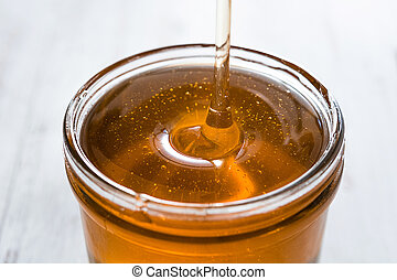 Pouring honey in jar
