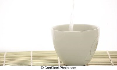 pouring hot water and instant coffe - hot water, a white cup...