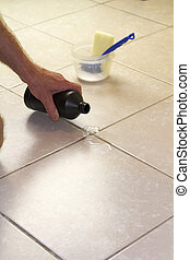 Pouring Hydrogen Peroxide on Floor Grout