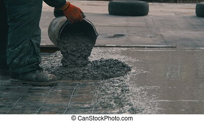Pouring, Laying Concrete at the Construction Site using Buckets of Cement.