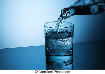 pouring mineral water in to a glass - A glass with pouring...