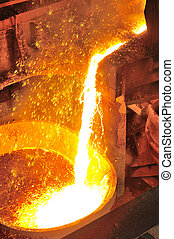 pouring molten metal - Pouring of liquid metal in open...