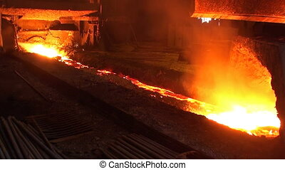Pouring of liquid metal from blast furnace at the metallurgical plant