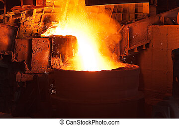 Pouring of liquid metal in open hearth workshop of the metallurgical plant