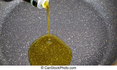 Pouring oil in pan for cooking. Closeup.