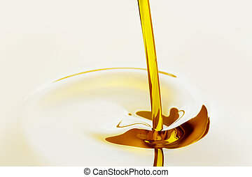Pouring oil  - Pouring liquid golden oil close up view