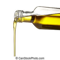 olive oil - pouring olive oil from glass bottle against...