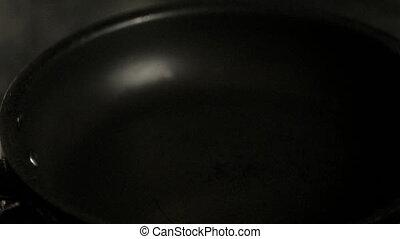 Pouring Olive Oil On Teflon Pan.