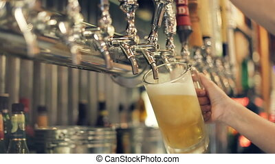 Pouring Perfect Draft Beer. A beer tap is a valve,...