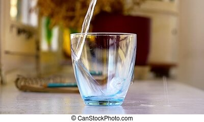 Pouring plain water Slow Motion - Pouring a glass of plain...
