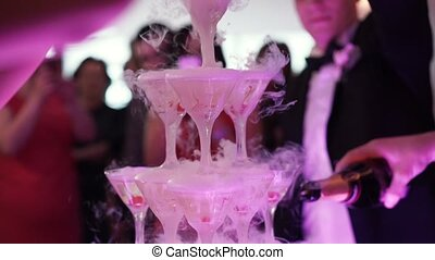 Pouring pyramid of champagne at the party