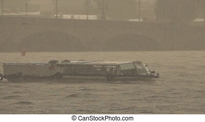 Pouring rain over the river and pleasure boat. Super slow...