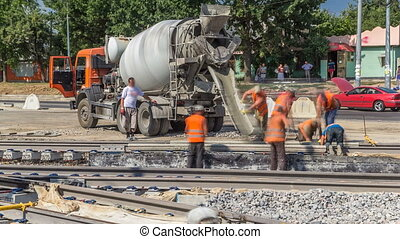 Pouring ready-mixed concrete after placing steel...