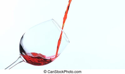 Pouring red wine in a glass.