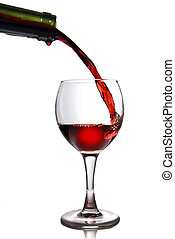 Pouring red wine in goblet