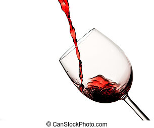 Pouring red wine in wine glass