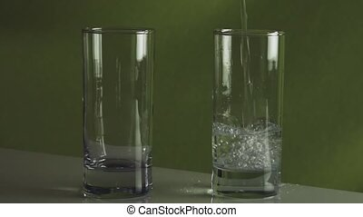 Pouring splashing water in glass slow motion stock footage video