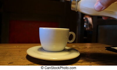 Pouring sugar into a cup